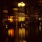Night reflections of house lights on canal by cascoly