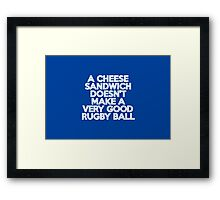 A cheese sandwich doesn't make a very good rugby ball Framed Print