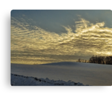 Evening clouds over the snow covered field Canvas Print