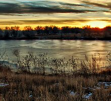 Frozen Pound and Sunset by Paul  Threlkel