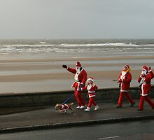 Santas going for a walk by Fiona MacNab
