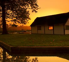 Sunset Through The Boat House by Rick Bowden