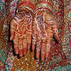 The wonderfully decorated hands and clothes of an Indian bride by ashishagarwal74