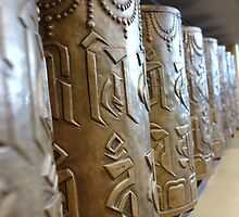 A row of Buddhist prayer wheels at Dharamshala by ashishagarwal74