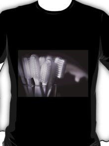 Toothbrushes in a glass T-Shirt