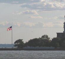 The Statue of Liberty and the Ellis Island  by tuerkiso