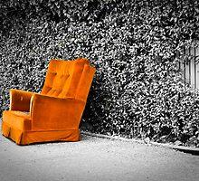 Orange armchair by Arek Rainczuk