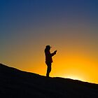 Woman in silhouette on Remarkable Rocks by Elana Bailey