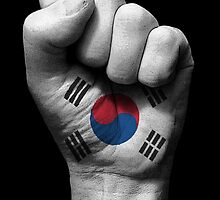 Flag of South Korea on a Raised Clenched Fist  by Jeff Bartels