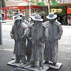Men in white coats by Maggie Hegarty