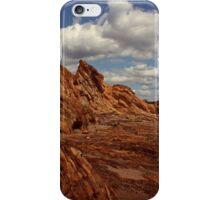 A beach walk becomes a rock climb. iPhone Case/Skin