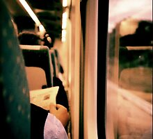 Man on train - Lomo LCA xpro lomographic analog 35mm film by edwardolive