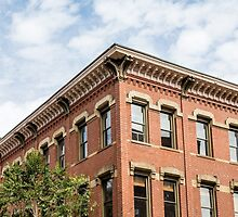 Old Brick Building and Sky by dbvirago