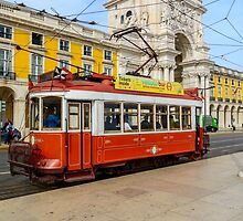 Old red tram at  triumphal arch on the Palace Square in Lisbon by 7horses