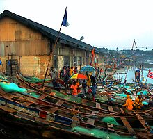 Boats and Umbrellas - Cape Coast, Ghana by Wayne King