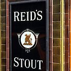 Reid's stout sign at Pub entrance, London, 1975, by David A. L. Davies