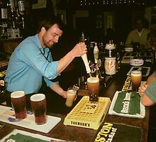 Landlord serving pints of beer, UK, 1995. by David A. L. Davies