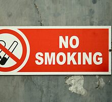 No Smoking sign on an old wall by ashishagarwal74