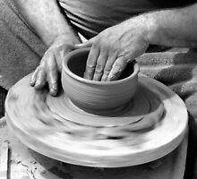 Potter's handsi in still motion by Linda Hollins