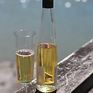 Bottle and glass with wine by photohunter