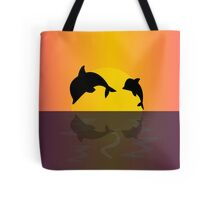 Dolphins at sunset Tote Bag