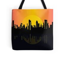 Sunset cityscape on the river Tote Bag