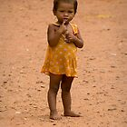Toddler in Kompong Kleang street by Adrianne Yzerman