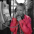 Pink Jacket in a Telephone Box by Graham Sessions