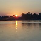 Sunset over Cedar Lake in Oscoda by snowbaby