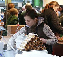Pastry Seller at Londons Borough Market by laurawhitaker