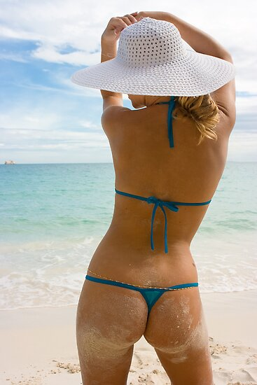 Blonde in white hat on the beach by Dmitry Rostovtsev