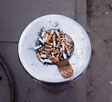 A lot of cigarettes stubbed out at a garbage bin by ashishagarwal74