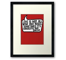 Handcuffs and Cheese Framed Print