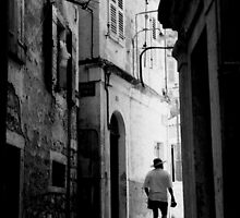 Man walking in Corfu by Brian Edwards
