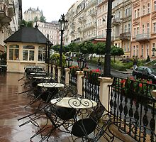Street cafe after the rain by Margarita K