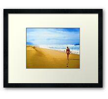 Walking along the beach Framed Print