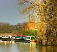 Narrowboat moored at locks by SimplyScene