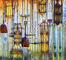 Sleds and tools on a barn wall by Rodney Williams