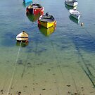 Fishing boats in Mousehole Harbour by Claire Aberl