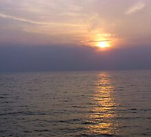 View of sunset through clouds and over the water of the Arabian Sea in Lakshadweep Islands by ashishagarwal74