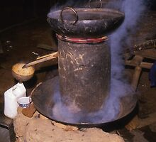 Making our own! Distillation in a Hill Tribe Village Pub. Northern Thailand. by Peter Stephenson