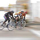 Cyclists Speeding into the Next Curve by Buckwhite