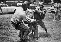 Deputy fighting suspect by Larry  Grayam