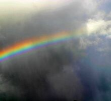 Rainbow in rainy sky by Lesley Ortiz