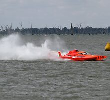 Racing boat returning to the lake bank after the race by David Hunt