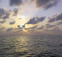 Sunset through the clouds over the water of the Arabian Sea off the Lakshadweep Islands by ashishagarwal74