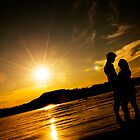 Happy couple in sunset by Vegard Giskehaug
