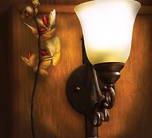 Orchid -  By  a near by lamp by Mike  Savad