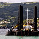 Dredger and barge working near the shore by mrfotos