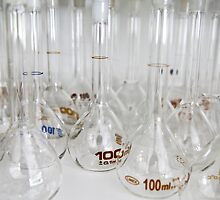 Belly test tubes standing in a chemistry lab by mrfotos
